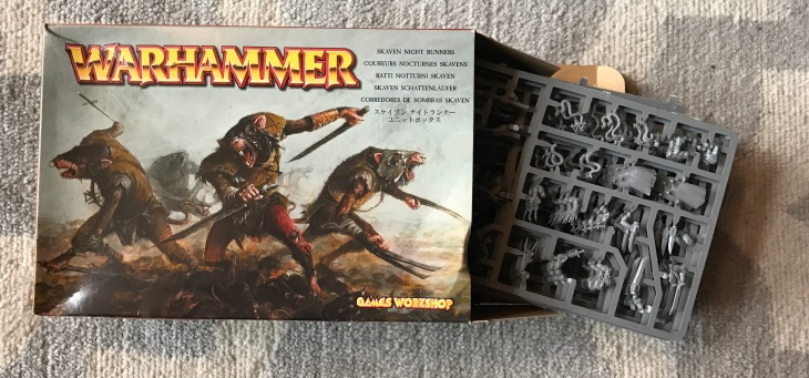 picture of the box and un-assembled figures